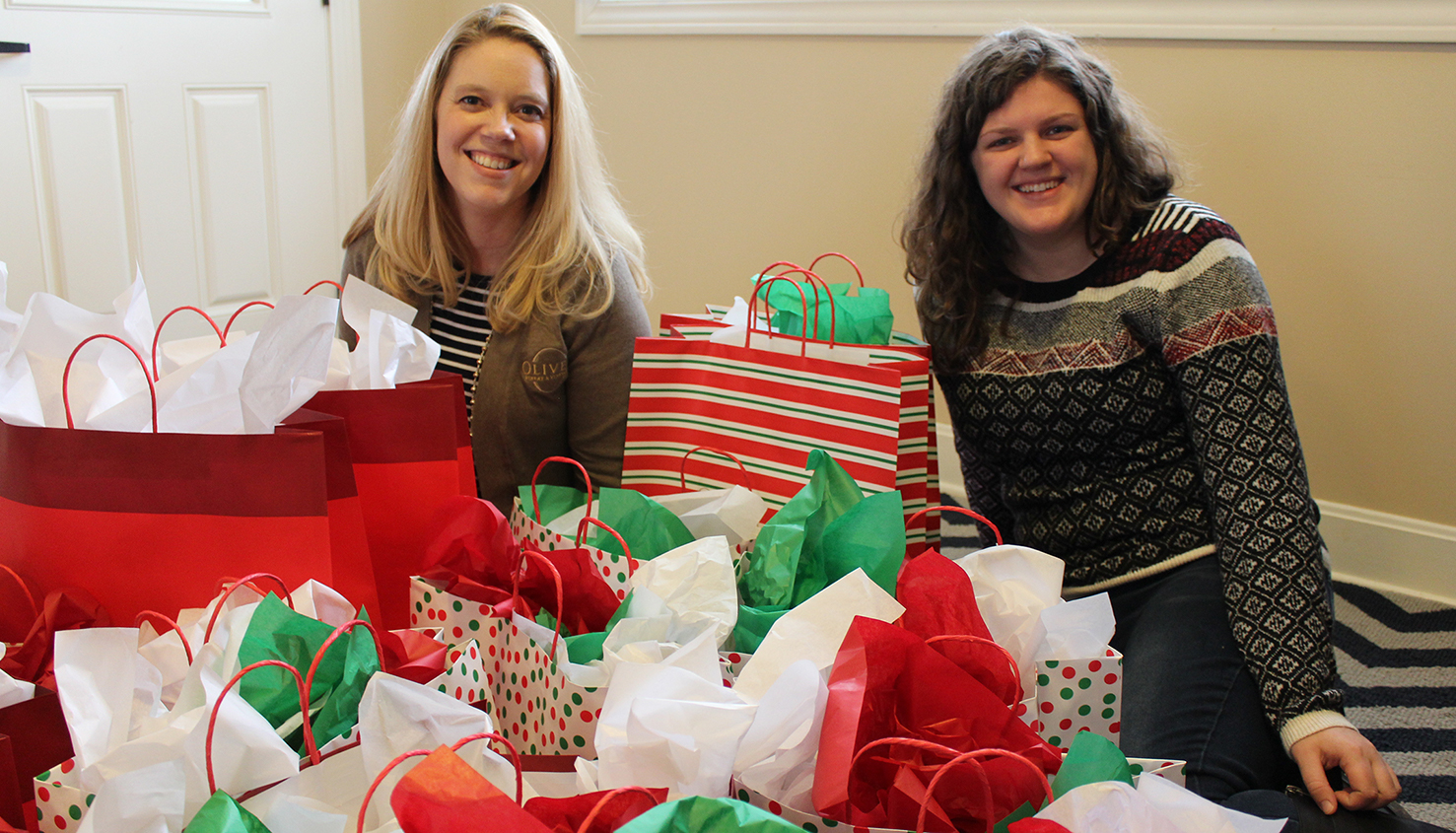 Staff members wrap gifts for families as part of our annual Monroe County United Ministries outreach.